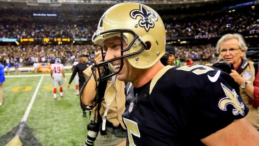Nov 1, 2015; New Orleans, LA, USA; New Orleans Saints kicker Kai Forbath (5) celebrates after kicking the game winning field goal against the New York Giants as time expired during the fourth quarter of a game at the Mercedes-Benz Superdome. The Saints defeated the Giants 52-49. Mandatory Credit: Derick E. Hingle-USA TODAY Sports