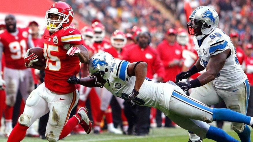 LONDON, ENGLAND - NOVEMBER 01: #35 Charcandrick West of Kansas City Chiefs carries the ball during the NFL game between Kansas City Chiefs and Detroit Lions at Wembley Stadium on November 01, 2015 in London, England. (Photo by Alan Crowhurst/Getty Images)