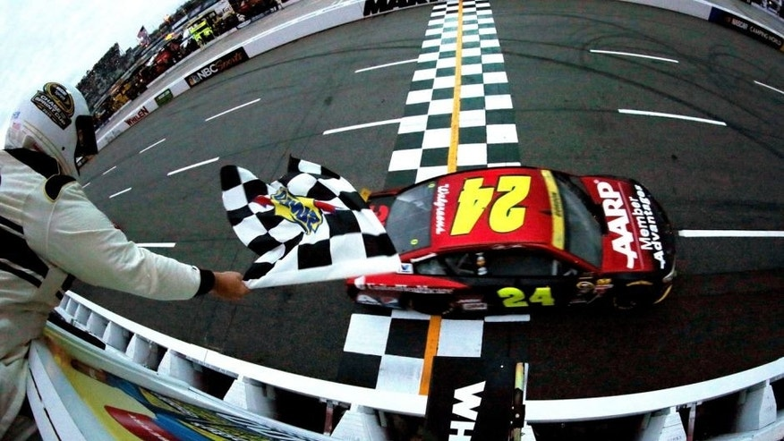 MARTINSVILLE, VA - NOVEMBER 01: Jeff Gordon, driver of the #24 AARP Member Advantages Chevrolet, takes the checkered flag to win the NASCAR Sprint Cup Series Goody's Headache Relief Shot 500 at Martinsville Speedway on November 1, 2015 in Martinsville, Virginia. (Photo by Todd Warshaw/NASCAR via Getty Images)