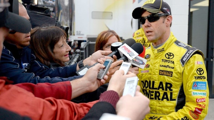 MARTINSVILLE, VA - NOVEMBER 01: Matt Kenseth, driver of the #20 Dollar General Toyota, speaks with the media after an on-track incident with Joey Logano, driver of the #22 Shell Pennzoil Ford, during the NASCAR Sprint Cup Series Goody's Headache Relief Shot 500 at Martinsville Speedway on November 1, 2015 in Martinsville, Virginia. (Photo by Robert Laberge/Getty Images)