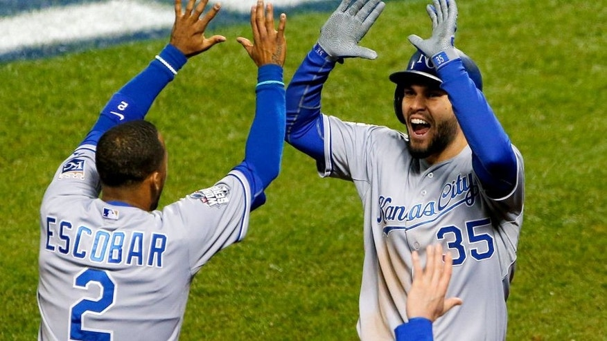 Oct 31, 2015; New York City, NY, USA; Kansas City Royals first baseman Eric Hosmer (35) celebrates with shortstop Alcides Escobar (2) after scoring a run against the New York Mets in the 8th inning in game four of the World Series at Citi Field. Mandatory Credit: Noah K. Murray-USA TODAY Sports