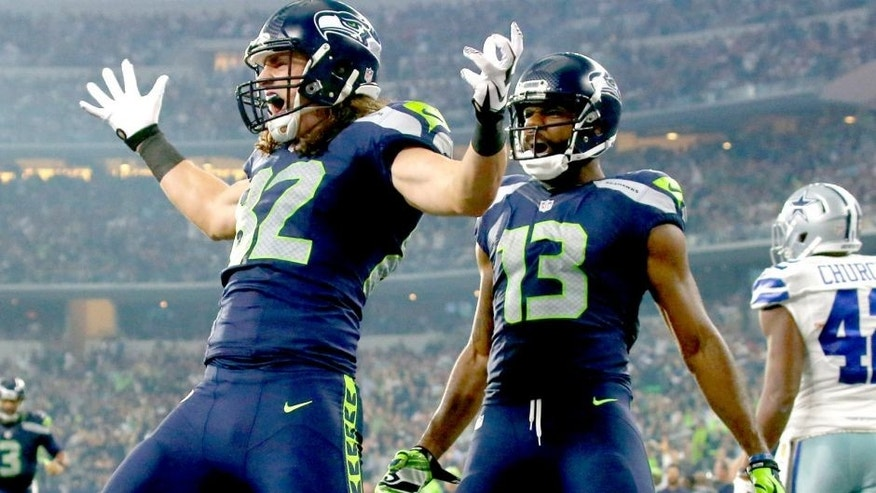 ARLINGTON, TX - NOVEMBER 1: Luke Willson #82 of the Seattle Seahawks celebrates as teammate Chris Matthews #13 looks on after scoring a touchdown against the Dallas Cowboys in the second quarter at AT&T Stadium on November 1, 2015 in Arlington, Texas. (Photo by Ronald Martinez/Getty Images)