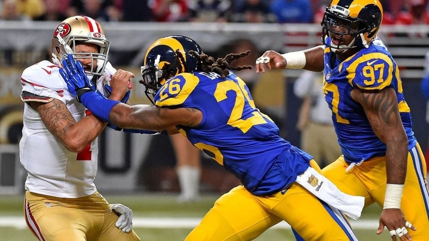Nov 1, 2015; St. Louis, MO, USA; St. Louis Rams defensive tackle Aaron Donald (99) and Mark Barron (26) tackle San Francisco 49ers quarterback Colin Kaepernick (7) during the second half at the Edward Jones Dome. Mandatory Credit: Jasen Vinlove-USA TODAY Sports