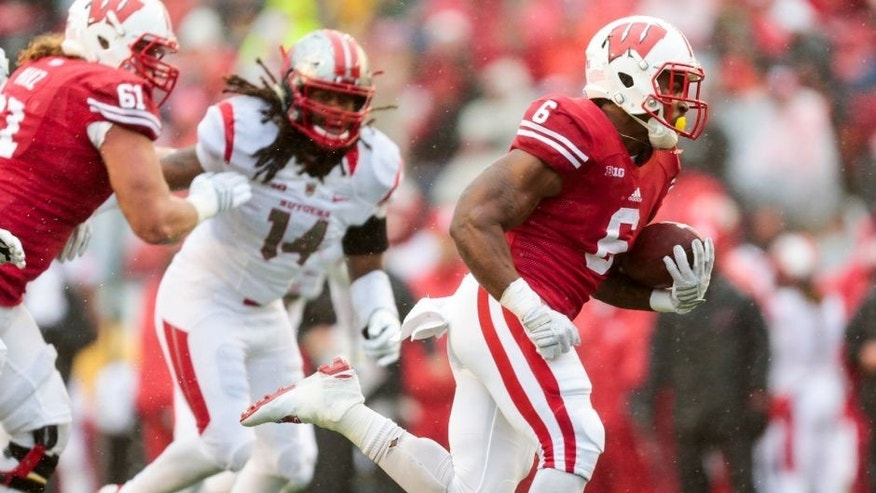 <p>Wisconsin running back Corey Clement (6) runs for a touchdown as Wisconsin offensive lineman Tyler Marz (61) defends against Rutgers Kaiwan Lewis (14) during the first half of an NCAA college football game Saturday, Oct. 31, 2015, in Madison, Wis. (AP Photo/Andy Manis)</p>