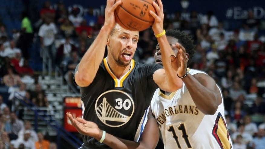 NEW ORLEANS, LA - OCTOBER 31: Stephen Curry #30 of the Golden State Warriors drives to the basket against Jrue Holiday #11 of the New Orleans Pelicans during the game on October 31, 2015 at Smoothie King Center in New Orleans, Louisiana. NOTE TO USER: User expressly acknowledges and agrees that, by downloading and or using this Photograph, user is consenting to the terms and conditions of the Getty Images License Agreement. Mandatory Copyright Notice: Copyright 2015 NBAE (Photo by Layne Murdoch Jr./NBAE via Getty Images)
