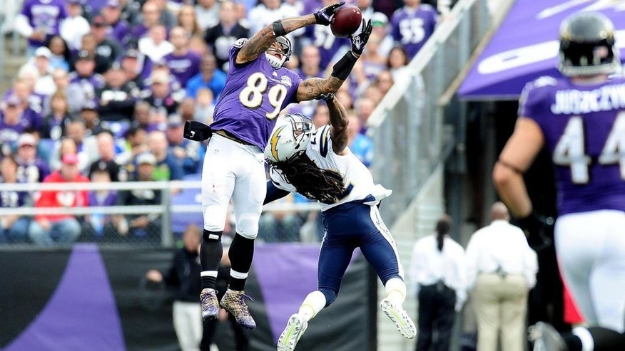 Nov 1, 2015; Baltimore, MD, USA; Baltimore Ravens wide receiver Steve Smith, Sr. (89) catches a pass over San Diego Chargers cornerback Jason Verrett (22) in the first quarter at M&T Bank Stadium. Mandatory Credit: Evan Habeeb-USA TODAY Sports