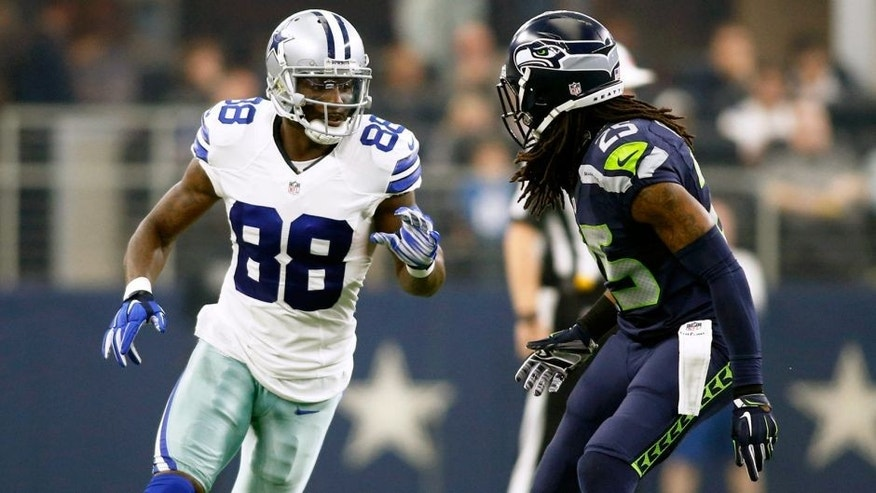 Nov 1, 2015; Arlington, TX, USA; Dallas Cowboys wide receiver Dez Bryant (88) runs a route against Seattle Seahawks cornerback Richard Sherman (25) in the first quarter at AT&T Stadium. Mandatory Credit: Tim Heitman-USA TODAY Sports