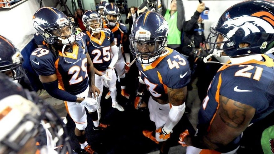 Nov 1, 2015; Denver, CO, USA; Denver Broncos strong safety T.J. Ward (43) and cornerback Bradley Roby (29) and cornerback Aqib Talib (21) and cornerback Chris Harris (25) and cornerback Aqib Talib (21) huddle before the game against the Green Bay Packers at Sports Authority Field at Mile High. Mandatory Credit: Ron Chenoy-USA TODAY Sports