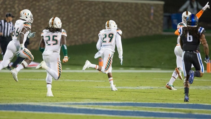 Miami's Corn Elder (29) returns a kickoff, which featured multiple laterals before Elder subsequently received the final lateral, and scores to beat Duke 30-27 in an NCAA college football game, in Durham, N.C., Saturday, Oct. 31, 2015. (AP Photo/Rob Brown)