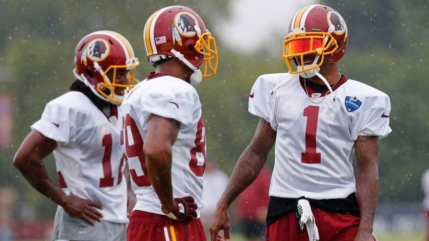 Jul 24, 2014; Richmond, VA, USA; Washington Redskins wide receiver DeSean Jackson (1) talks with Redskins wide receiver Santana Moss (89) and Redskins wide receiver Andre Roberts (12) during practice on day one of training camp at Bon Secours Washington Redskins Training Center. Mandatory Credit: Geoff Burke-USA TODAY Sports