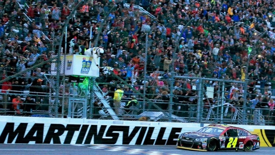 MARTINSVILLE, VA - NOVEMBER 01: Jeff Gordon, driver of the #24 AARP Member Advantages Chevrolet, crosses the finish line to win the NASCAR Sprint Cup Series Goody's Headache Relief Shot 500 at Martinsville Speedway on November 1, 2015 in Martinsville, Virginia. (Photo by Chris Trotman/NASCAR via Getty Images)