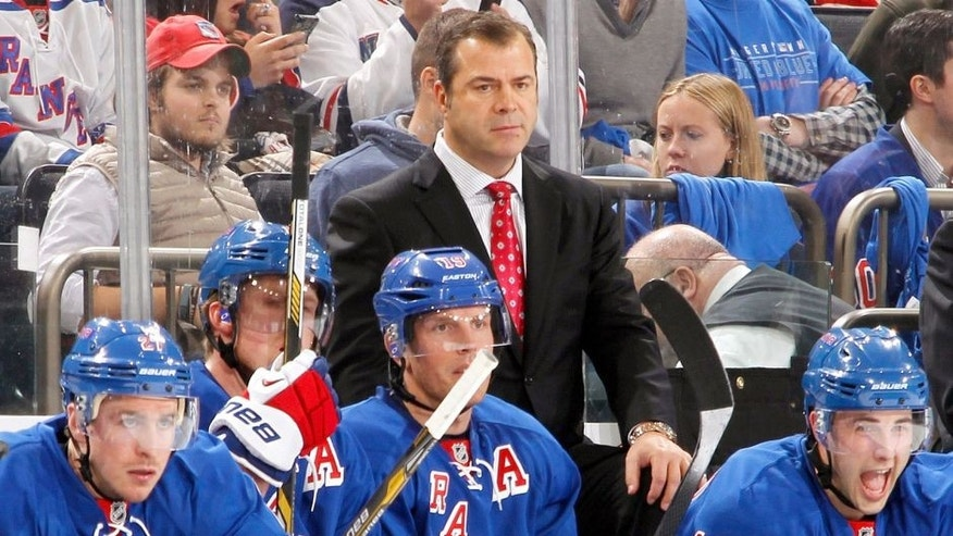 NEW YORK, NY - APRIL 17: Head Coach Alain Vigneault of the New York Rangers looks on from the bench against the Philadelphia Flyers in Game One of the First Round of the 2014 Stanley Cup Playoffs at Madison Square Garden on April 17, 2014 in New York City. The New York Rangers won 4-1. (Photo by Scott Levy/NHLI via Getty Images)