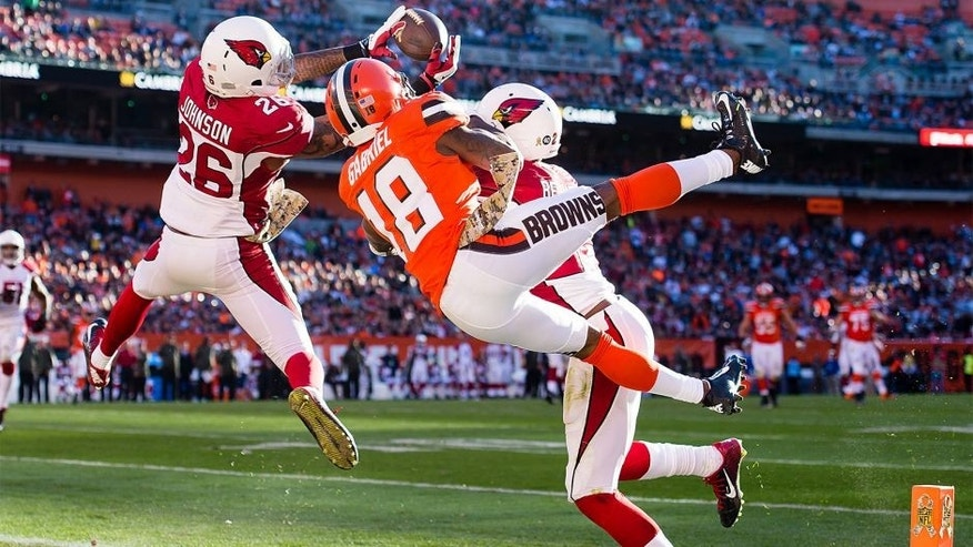CLEVELAND, OH - NOVEMBER 1: Free safety Rashad Johnson #26 of the Arizona Cardinals intercept a pass intended for wide receiver Taylor Gabriel #18 of the Cleveland Browns during the second half at FirstEnergy Stadium on November 1, 2015 in Cleveland, Ohio. The Cardinals defeated the Browns 34-20. (Photo by Jason Miller/Getty Images)