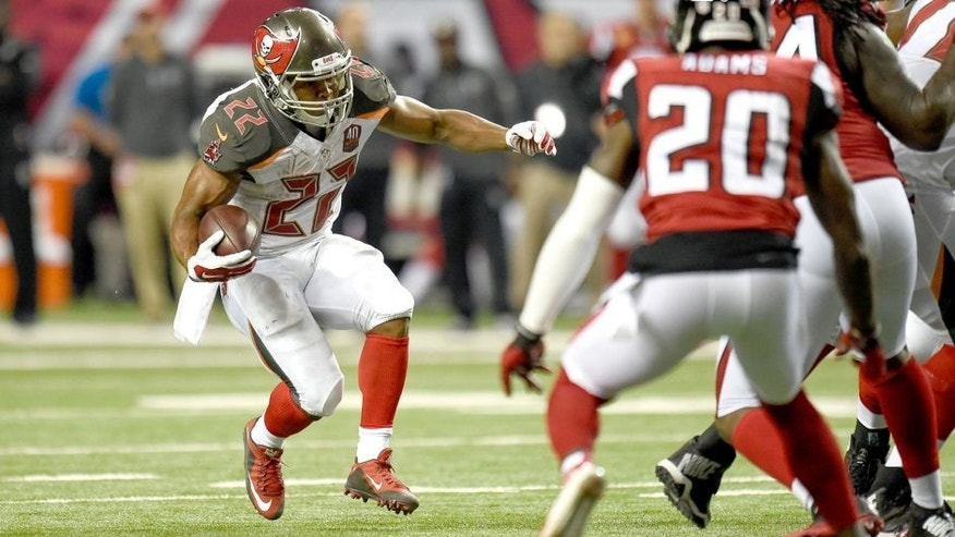 Nov 1, 2015; Atlanta, GA, USA; Tampa Bay Buccaneers running back Doug Martin (22) runs against the Atlanta Falcons during the second half at the Georgia Dome. The Buccaneers defeated the Falcons 23-20 in over time. Mandatory Credit: Dale Zanine-USA TODAY Sports