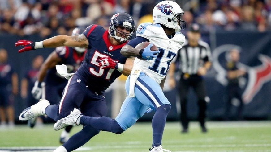 Nov 1, 2015; Houston, TX, USA; Tennessee Titans wide receiver Kendall Wright (13) avoids Houston Texans outside linebacker John Simon (51) in the second quarter at NRG Stadium. Mandatory Credit: Erich Schlegel-USA TODAY Sports