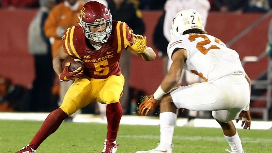 Oct 31, 2015; Ames, IA, USA; Iowa State Cyclones wide receiver Allen Lazard (5) runs with the football against Texas Longhorns cornerback John Bonney (24) during the second quarter at Jack Trice Stadium. Mandatory Credit: Reese Strickland-USA TODAY Sports
