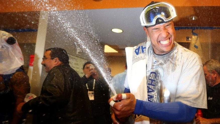 NEW YORK, NY - NOVEMBER 01: Salvador Perez #13 of the Kansas City Royals celebrates in the clubhouse after defeating the New York Mets to win Game Five of the 2015 World Series at Citi Field on November 1, 2015 in the Flushing neighborhood of the Queens borough of New York City. The Kansas City Royals defeated the New York Mets with a score of 7 to 2 to win the World Series. (Photo by Elsa/Getty Images)