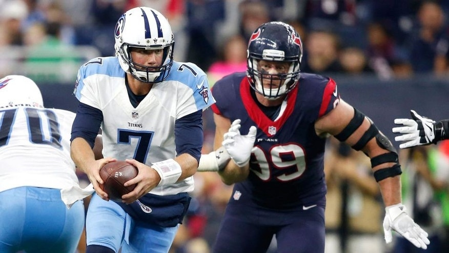 Nov 1, 2015; Houston, TX, USA; Houston Texans defensive end J.J. Watt (99) moves in on Tennessee Titans quarterback Zach Mettenberger (7) for a sack in the third quarter at NRG Stadium. Mandatory Credit: Erich Schlegel-USA TODAY Sports
