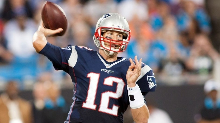 Aug 28, 2015; Charlotte, NC, USA; New England Patriots quarterback Tom Brady (12) passes the ball during the second quarter against the Carolina Panthers at Bank of America Stadium. Mandatory Credit: Jeremy Brevard-USA TODAY Sports