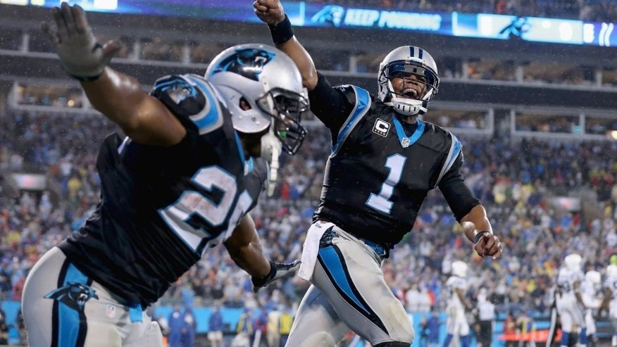 CHARLOTTE, NC - NOVEMBER 02: Cam Newton #1 and Jonathan Stewart #28 of the Carolina Panthers celebrate a touchdown against the Indianapolis Colts in the 1st quarter during their game at Bank of America Stadium on November 2, 2015 in Charlotte, North Carolina. (Photo by Streeter Lecka/Getty Images)