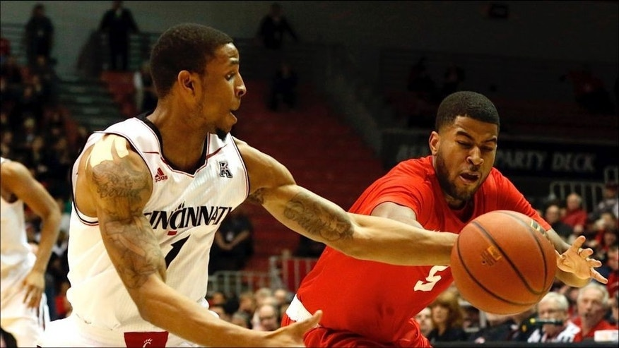<p>Jan 21, 2015; Cincinnati, OH, USA; Cincinnati Bearcats guard Deshaun Morman (1) grabs the loose ball from Houston Cougars guard L.J. Rose (5) during the first half at Fifth Third Arena. Mandatory Credit: Aaron Doster-USA TODAY Sports</p>