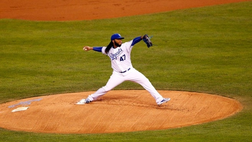 Johnny Cueto #47 of the Kansas City Royals throws a pitch in the first inning against the New York Mets in Game Two of the 2015 World Series at Kauffman Stadium on October 28, 2015 in Kansas City, Missouri.  (Photo by Kyle Rivas/Getty Images)