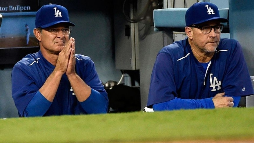 October 15, 2015; Los Angeles, CA, USA; Los Angeles Dodgers manager Don Mattingly (8) and bench coach Tim Wallach (29) watch game action in the third inning against New York Mets in game five of NLDS at Dodger Stadium. Mandatory Credit: Richard Mackson-USA TODAY Sports
