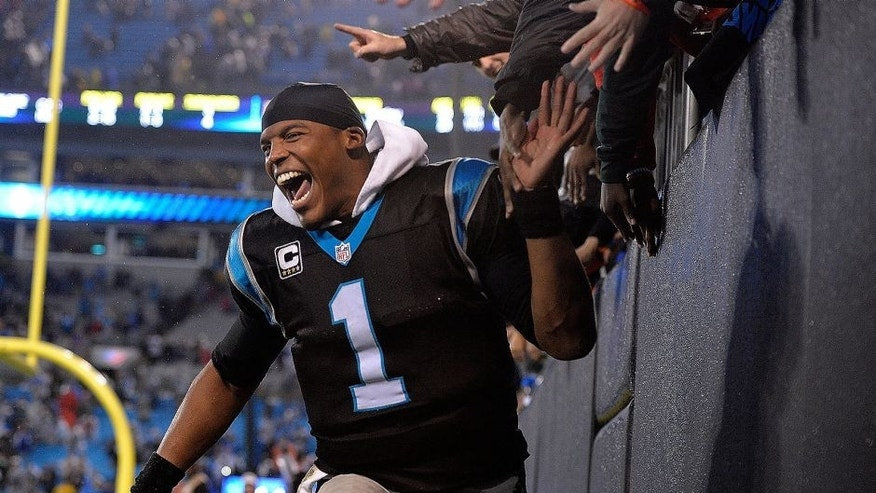 "<p style=""font-family: tahoma, arial, helvetica, sans-serif; font-size: 12px;"">CHARLOTTE, NC - NOVEMBER 02: Cam Newton #1 of the Carolina Panthers celebrates with fans after a win against the Indianapolis Colts at Bank of America Stadium on November 2, 2015 in Charlotte, North Carolina. The Panthers won 29-26 in overtime. (Photo by Grant Halverson/Getty Images)</p>"