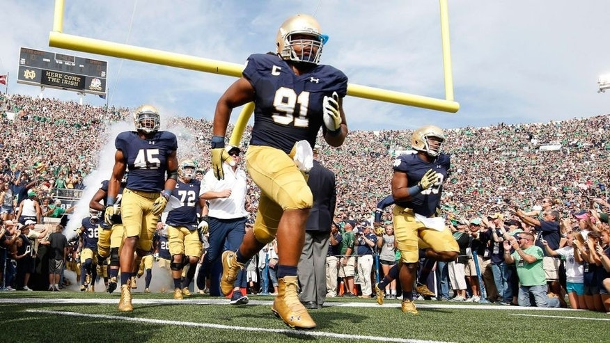 Sep 26, 2015; South Bend, IN, USA; Notre Dame Fighting Irish defensive lineman Sheldon Day (91) leads the team onto the field before the game against the Massachusetts Minutemen at Notre Dame Stadium. Mandatory Credit: Brian Spurlock-USA TODAY Sports