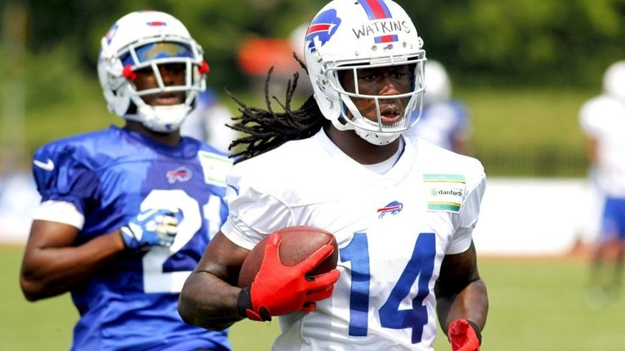 Buffalo Bills wide receiver Sammy Watkins (14) runs after a reception against corner back Leodis McKelvin (21) during their NFL football training camp in Pittsford, N.Y., Monday, July 21, 2014. (AP Photo/Bill Wippert)