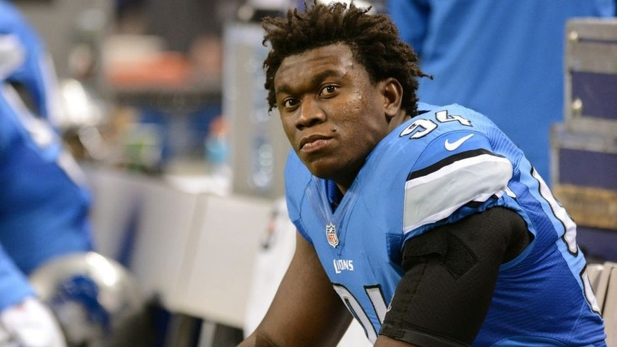 DETROIT, MI - DECEMBER 22: Ezekiel Ansah #94 of the Detroit Lions looks on from the sidelines during the game against the New York Giants at Ford Field on December 22, 2013 in Detroit, Michigan. The Giants defeated the Lions 23-20. (Photo by Mark Cunningham/Detroit Lions/Getty Images)