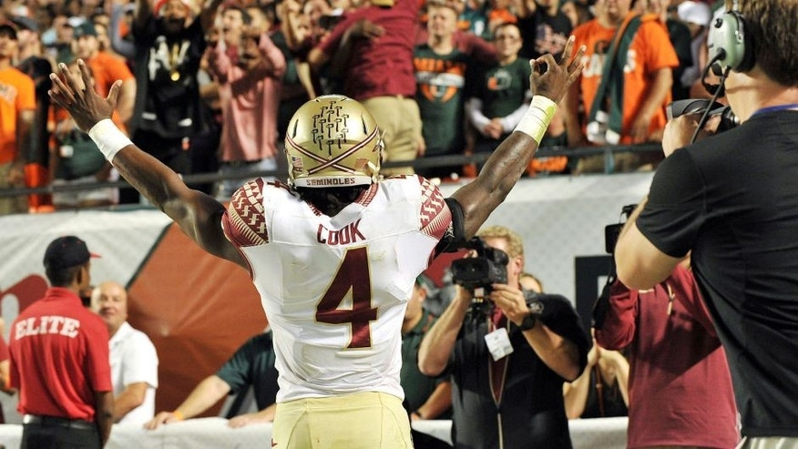 Nov 15, 2014; Miami Gardens, FL, USA; Florida State Seminoles running back Dalvin Cook (4) reacts after scoring a touchdown against the Miami Hurricanes during the second half at Sun Life Stadium. FSU won 30-26. Mandatory Credit: Steve Mitchell-USA TODAY Sports