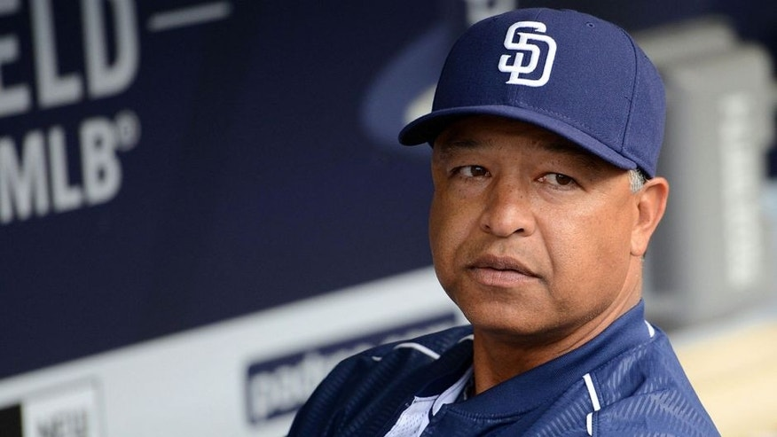 Jun 15, 2015; San Diego, CA, USA; San Diego Padres interim manager Dave Roberts (8) looks on from the dugout prior to the game against the Oakland Athletics at Petco Park. Mandatory Credit: Jake Roth-USA TODAY Sports