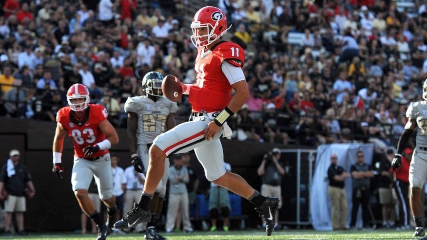 Sep 12, 2015; Nashville, TN, USA; Georgia Bulldogs quarterback Greyson Lambert (11) runs in for a touchdown during the second half against the Vanderbilt Commodores at Vanderbilt Stadium. Georgia won 31-14. Mandatory Credit: Christopher Hanewinckel-USA TODAY Sports