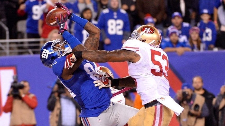 Oct 11, 2015; East Rutherford, NJ, USA; New York Giants tight end Larry Donnell (84) catches the game winning touchdown in front of San Francisco 49ers inside linebacker NaVorro Bowman (53) during the fourth quarter at MetLife Stadium. Mandatory Credit: Robert Deutsch-USA TODAY Sports
