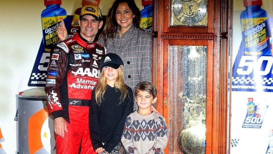 MARTINSVILLE, VA - NOVEMBER 01: Jeff Gordon, driver of the #24 AARP Member Advantages Chevrolet, his wife Ingrid Vandebosch, and their children Ella and Leo pose for a photo in Victory Lane after winning the NASCAR Sprint Cup Series Goody's Headache Relief Shot 500 at Martinsville Speedway on November 1, 2015 in Martinsville, Virginia. (Photo by Chris Trotman/NASCAR via Getty Images)