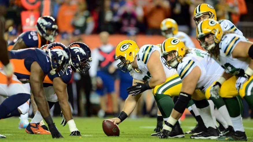 Green Bay Packers center Corey Linsley lines up to hike the football across from the Denver Broncos in the first quarter at Sports Authority Field at Mile High in Denver on Sunday, Nov. 1, 2015.