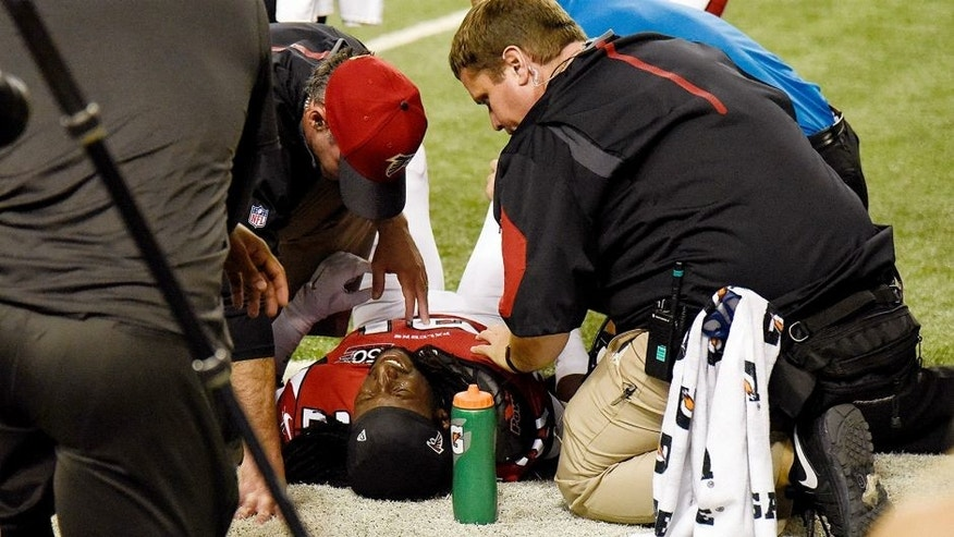 Nov 1, 2015; Atlanta, GA, USA; Atlanta Falcons cornerback Desmond Trufant (21) is attended by team personnel after being injured against the Tampa Bay Buccaneers during the second half at the Georgia Dome. The Buccaneers defeated the Falcons 23-20 in over time. Mandatory Credit: Dale Zanine-USA TODAY Sports