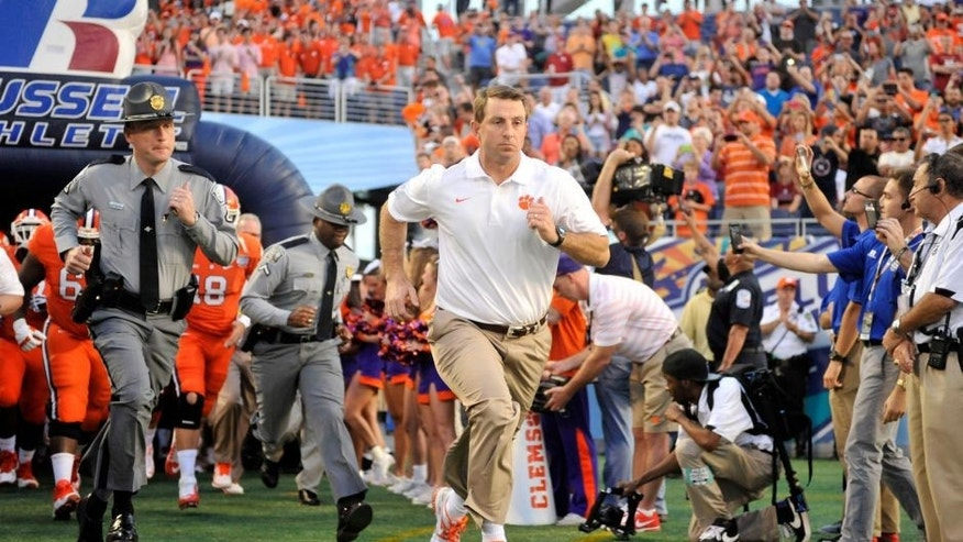Dec 29, 2014; Orlando, FL, USA; Clemson Tigers head coach Dabo Swinney runs onto the field before the 2014 Russell Athletic Bowl at Florida Citrus Bowl. Mandatory Credit: David Manning-USA TODAY Sports