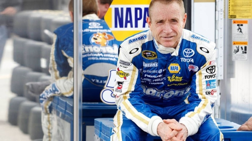 DAYTONA BEACH, FL - FEBRUARY 22: Mark Martin, driver of the #55 Aaron's Toyota, sits behind the team hauler in the garage area during practice for the NASCAR Sprint Cup Series Daytona 500 at Daytona International Speedway on February 22, 2012 in Daytona Beach, Florida. (Photo by Todd Warshaw/Getty Images for NASCAR)