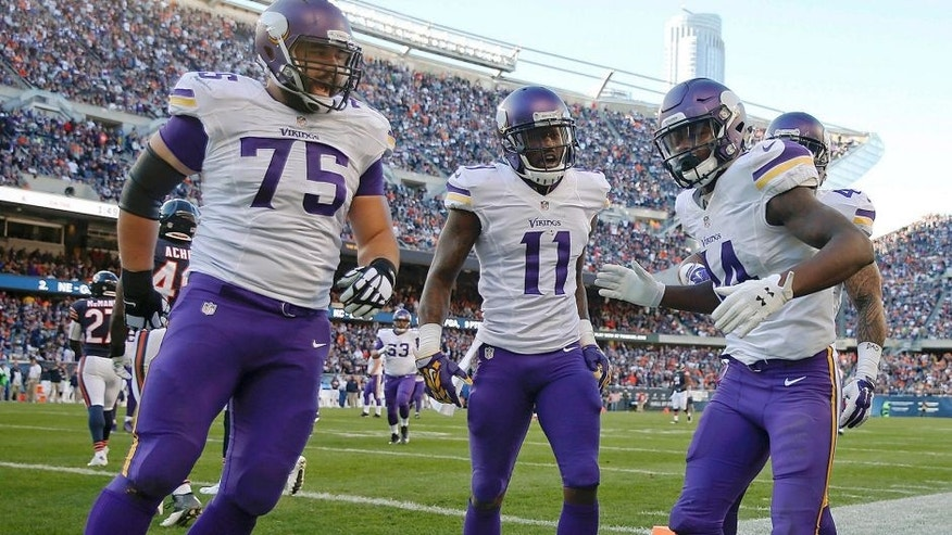 Nov 1, 2015; Chicago, IL, USA; Minnesota Vikings wide receiver Stefon Diggs (14) celebrates with teammates after scoring a touchdown against the Chicago Bears during the fourth quarter at Soldier Field. The Vikings won 23-20. Mandatory Credit: Kamil Krzaczynski-USA TODAY Sports