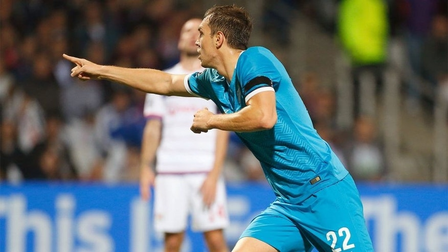 LYON, FRANCE - NOVEMBER 4: Artem Dzyuba of FC Zenit celebrates scoring the first goal during the UEFA Champions league match between Olympique Lyonnais (OL) and FC Zenit St Petersburg at Stade de Gerland on November 4, 2015 in Lyon, France. (Photo by Jean Catuffe/Getty Images)