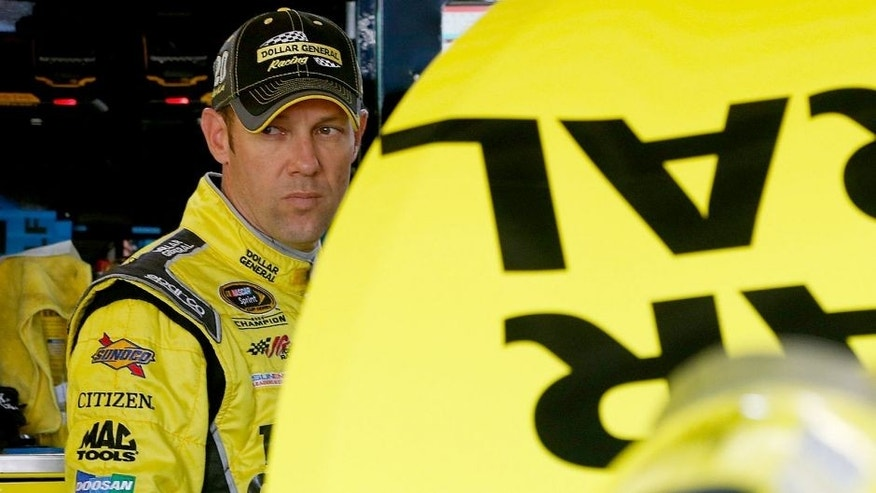 KANSAS CITY, KS - OCTOBER 16: Matt Kenseth, driver of the #20 Dollar General Toyota, stands in the garage area during practice for the NASCAR Sprint Cup Series Hollywood Casino 400 at Kansas Speedway on October 16, 2015 in Kansas City, Kansas. (Photo by Brian Lawdermilk/NASCAR via Getty Images)