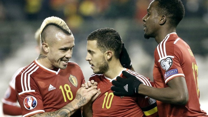BRUSSELS, BELGIUM - OCTOBER 13: Eden Hazard of Belgium #10 celebrates his goal with Radja Nainggolan and Divock Origi of Belgium during the UEFA EURO 2016 qualifier match between Belgium and Israel at King Baudouin Stadium (Stade du Roi Baudouin) on October 13, 2015 in Brussels, Belgium. (Photo by Jean Catuffe/Getty Images)