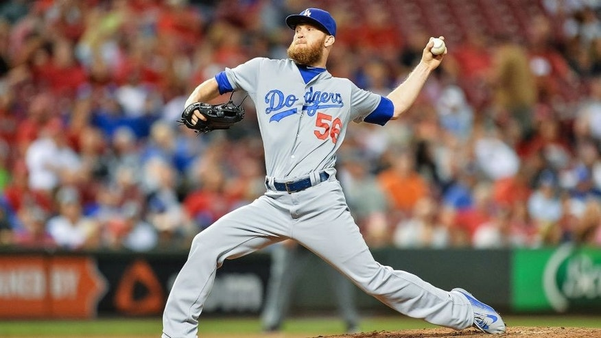 CINCINNATI, OH - AUGUST 25: J.P. Howell #56 of the Los Angeles Dodgers pitches against the Cincinnati Reds at Great American Ball Park on August 25, 2015 in Cincinnati, Ohio. (Photo by Jamie Sabau/Getty Images)