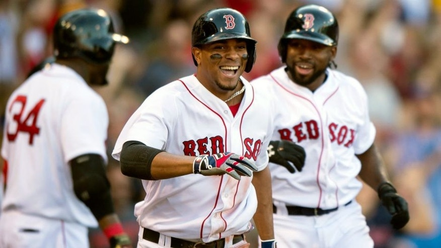 BOSTON, MA - SEPTEMBER 5: Xander Bogaerts #2 of the Boston Red Sox reacts after hitting a bases clearing triple and then scoring on a throwing error during the fourth inning against the Philadelphia Phillies at Fenway Park on September 5, 2015 in Boston, Massachusetts. (Photo by Michael Ivins/Boston Red Sox/Getty Images)