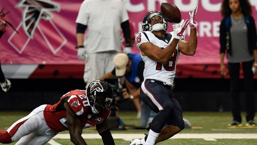 Oct 4, 2015; Atlanta, GA, USA; Houston Texans wide receiver Cecil Shorts III (18) catches a long pass behind Atlanta Falcons defensive back Phillip Adams (20) during the second half at the Georgia Dome. The Falcons defeated the Texans 48-21. Mandatory Credit: Dale Zanine-USA TODAY Sports