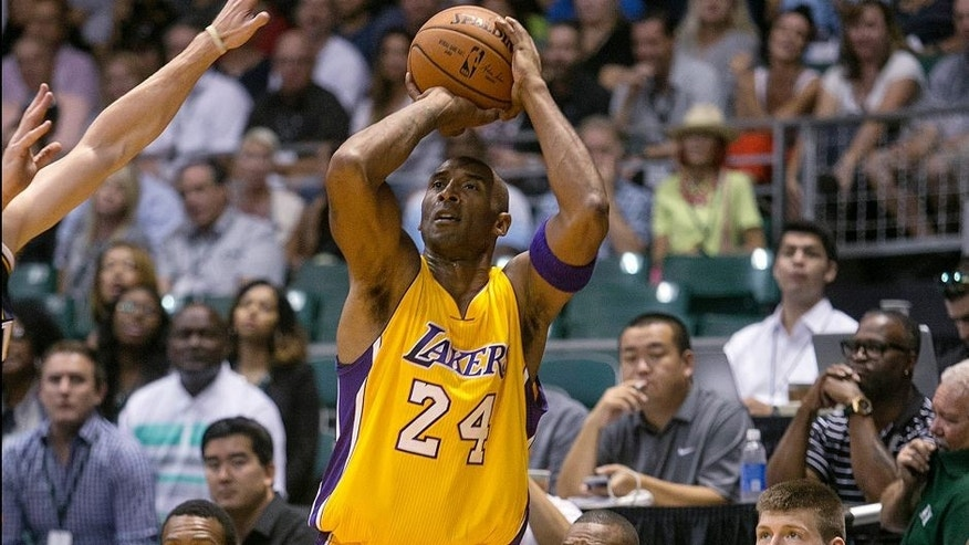 <p>Los Angeles Lakers guard Kobe Bryant (24) attempts a three point shot against Utah during the first quarter of a preseason NBA basketball game, Sunday, Oct. 4. 2015, in Honolulu. (AP Photo/Marco Garcia)</p>