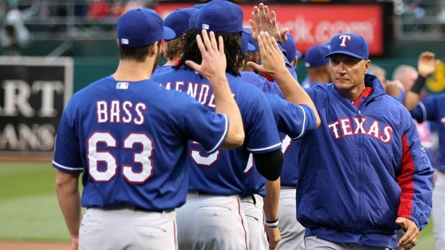 Apr 6, 2015; Oakland, CA, USA; Texas Rangers manager Jeff Banister (28) high fives his players before the game against the Oakland Athletics at O.co Coliseum. Mandatory Credit: Kelley L Cox-USA TODAY Sports