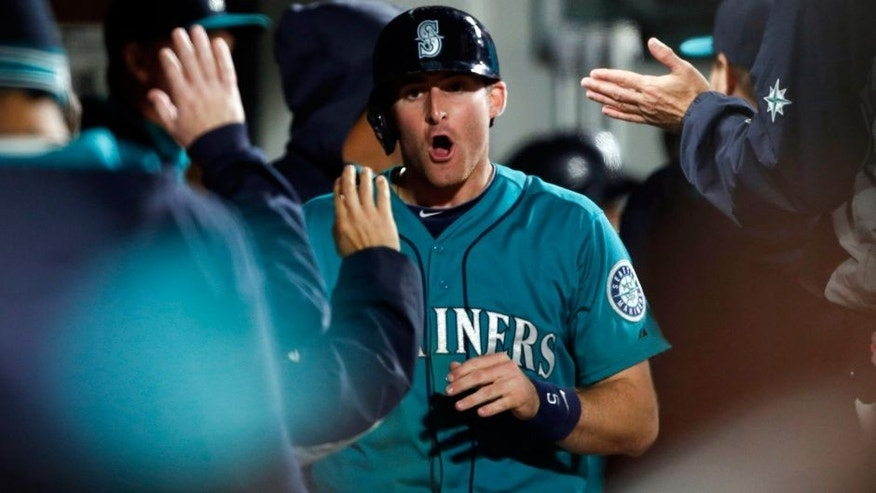 Oct 2, 2015; Seattle, WA, USA; Seattle Mariners center fielder Brad Miller (5) yells out after hitting a solo home run against the Oakland Athletics in the fifth inning at Safeco Field. Mandatory Credit: Jennifer Buchanan-USA TODAY Sports